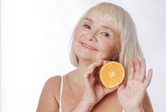 Positive joyful woman inclining her head Stock Image