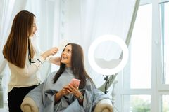 Free Positive Joyful Woman Looking At Her Hair Stylist Royalty Free Stock Photo - 122018705