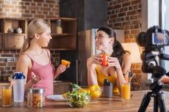 Positive joyful women talking to each other Royalty Free Stock Image