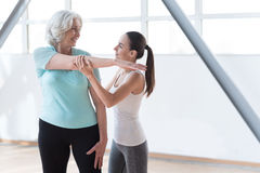 Positive joyful women training in a fitness club Stock Images