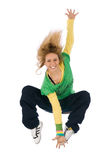 Positive jumping. A beautiful girl jumping over white Royalty Free Stock Image