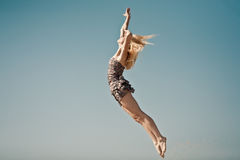 Positive jumping in sky Stock Images