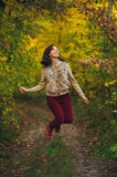 Positive jumping woman Stock Photo