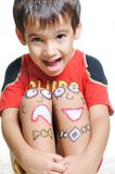 Positive kid with arts. On his body Stock Image