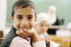 Positive kid in classroom smiling Royalty Free Stock Image