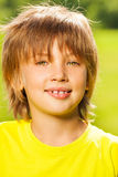 Positive kid in yellow T-shirt portrait. In summer Royalty Free Stock Image