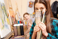 Positive kids having fun during the painting lesson Royalty Free Stock Image