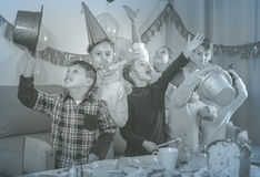 Positive kids having a good time at a birthday party Stock Photo