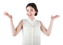 A positive lady. A beautiful young woman isolated on a white background. An excited casual female. A happy girl putting hands up. A joyful brunette young lady Royalty Free Stock Photography