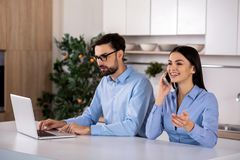 Positive colleagues sitting at the table stock image
