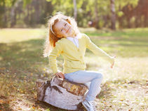 Positive little child having fun in autumn Stock Image