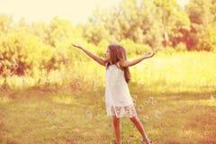 Positive little girl having fun. Soap bubbles stock images