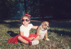 Positive little girl with her pet Royalty Free Stock Image