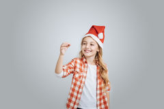 Positive little girl holdign New Year toys Stock Image