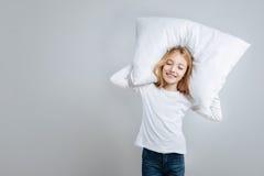 Positive little girl pretending to sleep Stock Image