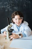 Positive little scientist studying biotechnology in the laboratory Royalty Free Stock Image