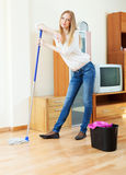 Positive long-haired housewife   with mop Stock Images