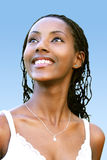 Positive look. Beautiful coloured woman with a bright smile Stock Photography