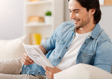 Positive ma reading newspaper Stock Photo