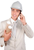 Positive male architect talking on phone Royalty Free Stock Image