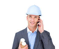 Positive male architect talking on phone Royalty Free Stock Photography