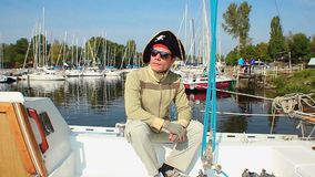 Positive male, black pirate hat on, yachting, vacation, tourism. Stock footage stock video
