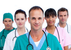 Positive male doctor and his medical team. Against a white background Royalty Free Stock Photo