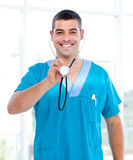 Positive male doctor holding a stethoscope Stock Images
