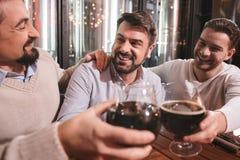 Positive male friends having fun Stock Image
