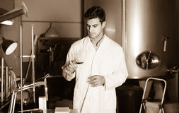 Positive male laboratorian working with wine Stock Photos