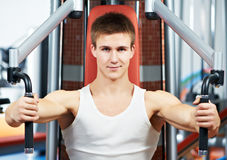 Positive man at chest pectoral exercises machine Royalty Free Stock Image