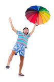 Positive man with colorful umbrella isolated on Royalty Free Stock Images