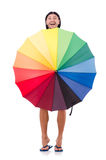 Positive man with colorful umbrella isolated on Stock Photography