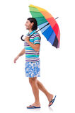 Positive man with colorful umbrella isolated on Royalty Free Stock Image