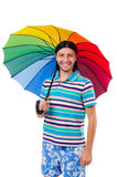 Positive man with colorful umbrella isolated on Stock Photo