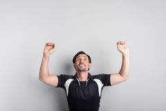 Positive man doing exercises on the horizontal bar Stock Photo
