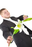 Positive man with flower. Man with flower. Isolated over white Royalty Free Stock Photography