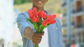 Positive man giving flowers into camera, delivery of bouquets, romantic present. Stock footage stock video