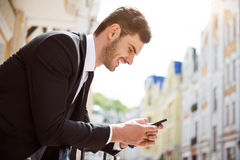 Positive man holding cell phone Royalty Free Stock Photo