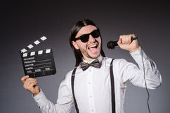 Positive man holding clapperboard Royalty Free Stock Photo