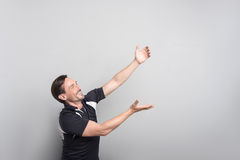 Positive man holding a cup Royalty Free Stock Photography