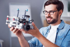 Positive man holding robot Stock Images