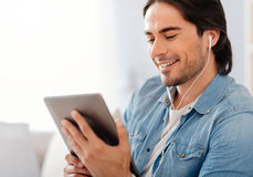 Positive man listening to music Royalty Free Stock Images