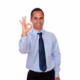 Positive man looking and showing you ok sign Royalty Free Stock Image