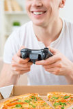 Positive man playing video game Stock Photography