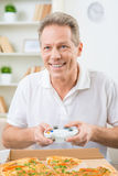 Positive man playing video game Stock Images