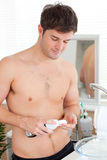 Positive man ready to shave in the bathroom Royalty Free Stock Photo