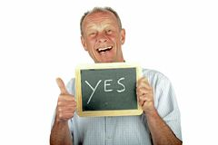 Positive man showing thumbs up with sign '' yes'' Royalty Free Stock Image