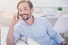 Positive man talkign on cellphone Stock Photos