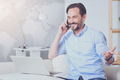 Positive man talking on cell phone Stock Photography